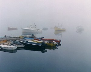 boats in foggy harbor