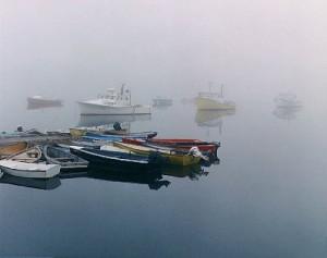 boats in foggy harbor